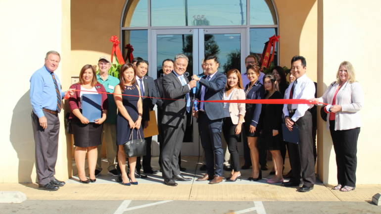 Cutting the Ribbon at Real Estates Unlimited